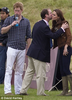 Prince Harry looks on as Kate gets a goodbye kiss from Polo manager Andrew Tucker.