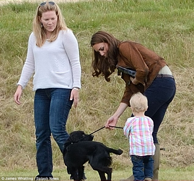 Kate and Lupo play with Peter Phillips's wife Autumn and her daughter Savannah