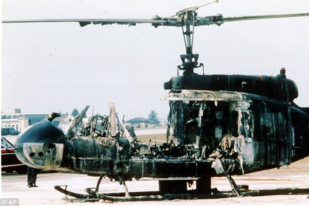 Defeat: The burned wreckage of the helicopter in which nine Israelis held hostage were killed after a botched rescue mission