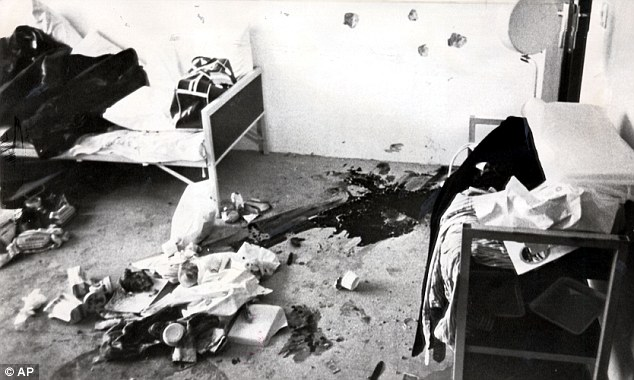 Blood and bullet holes cover the floor and walls where one of the two Israeli killed in their apartment was murdered
