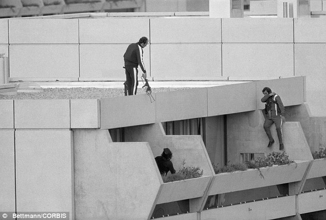 Failure: Armed police drop into position on a terrace directly above the apartments. But they did not try and rescue the hostages