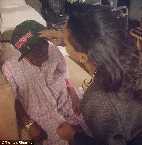 Young at heart: The singer was also seen putting her trucker cap on her elderly relative who is suffering from cancer