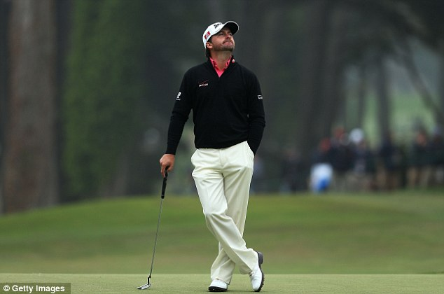 Not his day: Graeme McDowell battled hard but came up short in his bid for a second major championship