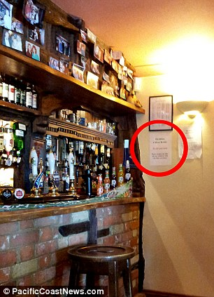 Don't leave your children: The tongue in cheek message to David Cameron left at The Swan pub near Chequers, the Prime Minister's country retreat in Buckinghamshire