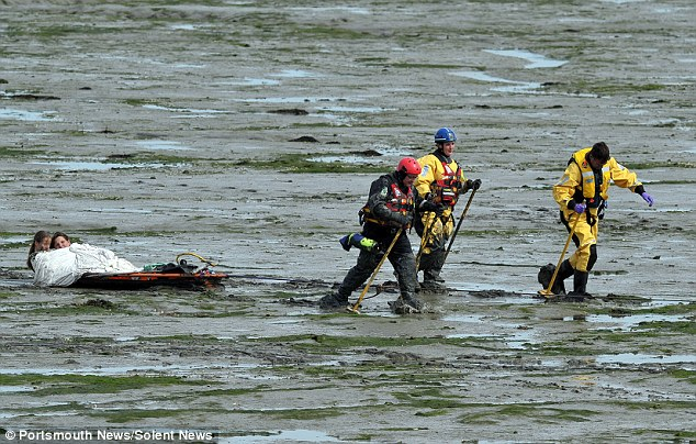 Dirty: The girls, caked in thick black mud, had been attempting to rescue their dog in Langstone Harbour when they got into difficulties