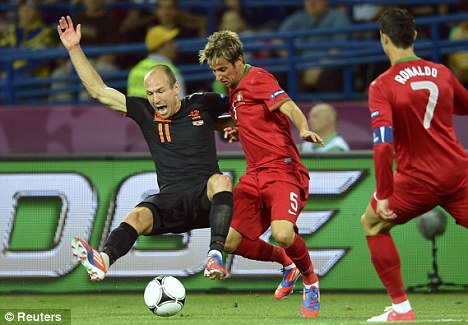Dumped out: Arjen Robben and his colleagues depart without a point