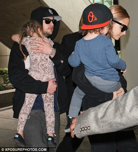 Sleepyheads: Nicole Richie and husband Joel Madden carried their children Harlow and Sparrow through LAX after returning from Sydney