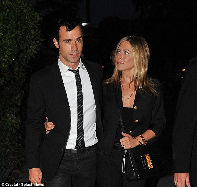 The couple looked loved-up as they strolled around Paris in matching black ensembles