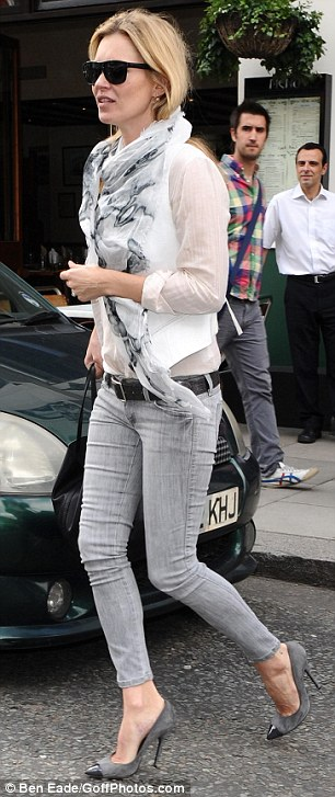 Sunny but a grey day: Kate looked chic but kept it simple in skinny jeans, stilettos, blouse and scarf