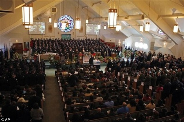 In mourning: Leak said he carries out scores of funerals each year, like that pictured, for young people and teenagers who are the victims of fatal shootings