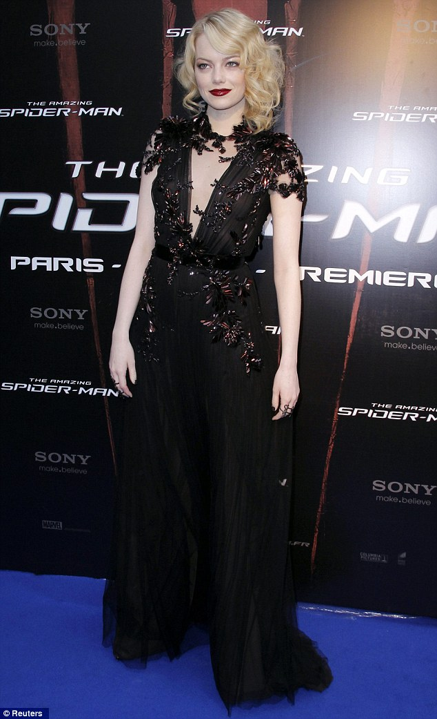 The lady is a vamp: Emma Stone arrives for the Paris premiere of The Amazing Spider-Man in a very sexy Gucci gown