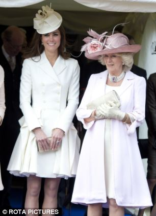 Shades of pale: The Duchess of Cambridge chose a cream double-breasted coat-dress, while Camilla looked chic in pale pink coat and cream dress