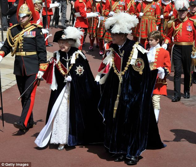 Splendid show: The Queen herself hands out the Order of the Garter, and unlike with her OBE or CBE honours list, does not need to consult the Government to do so
