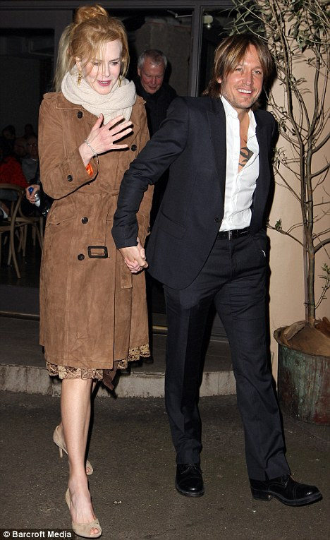 The birthday girl: Nicole Kidman and husband Keith Urban leave The Apollo restaurant in Sydney today