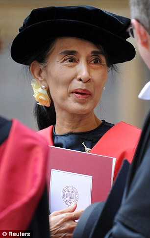 Aung San Suu Kyi holds her honorary degree at the Bodleian Library in Oxford