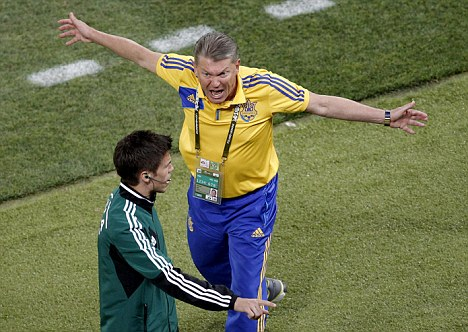 Rage: Ukraine coach Oleg Blokhin went wild after his side were denied