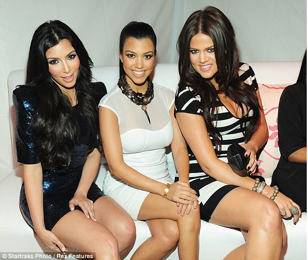Kim (left) with her reality star sisters Kourtney (centre) and Khloe (right)