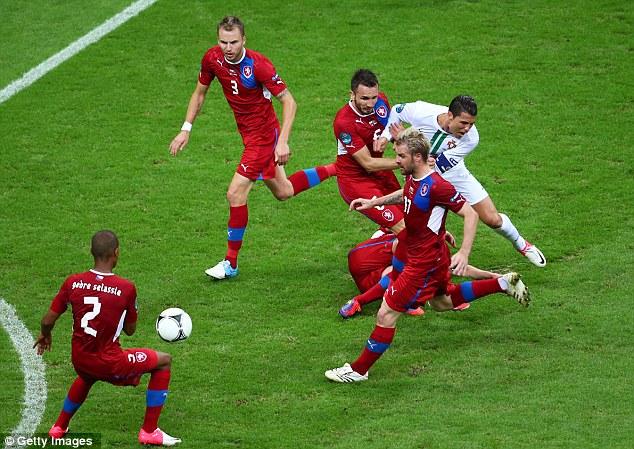 One way to stop him: Tomas Sivok and David Limbersky gang up on Cristiano Ronaldo