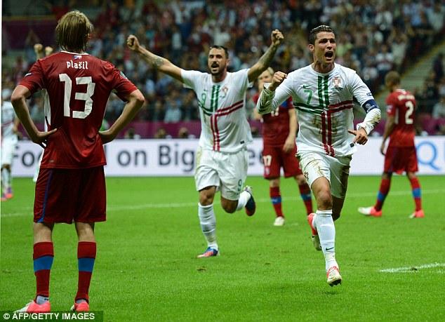 On the money: Cristiano Ronaldo wheels away after hitting the winner