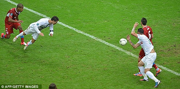Thumping: Cristiano Ronaldo nods Portugal into the semi-finals with this magnificent header