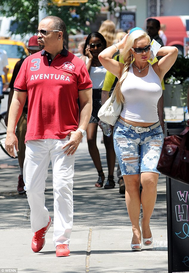 Plenty of curves: On top, Coco also showed off her voluptuous figure in a very tight white tank top