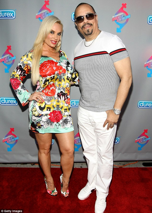 Dressed to impress: Coco later changed into a floral dress as she and  Ice-T walked the red carpet at the Durex Get In-Sync Party