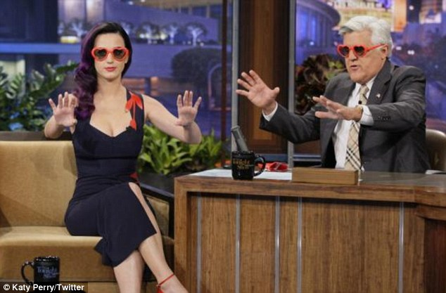 'Caption this!': Katy asked her followers on Twitter to put forward a description for this picture of her and Jay Leno wearing their 3D glasses