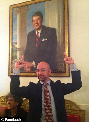 Activist Matthew Hart posted a photo of himself showing both middle fingers in front of Ronald Reagan's portrait with the caption 'F--- Reagan'