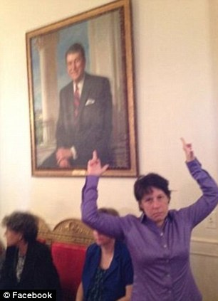 Photographer Zoe Strauss posted a picture of herself on Facebook 'flipping the bird' in front of President Reagan's portrait in the White House