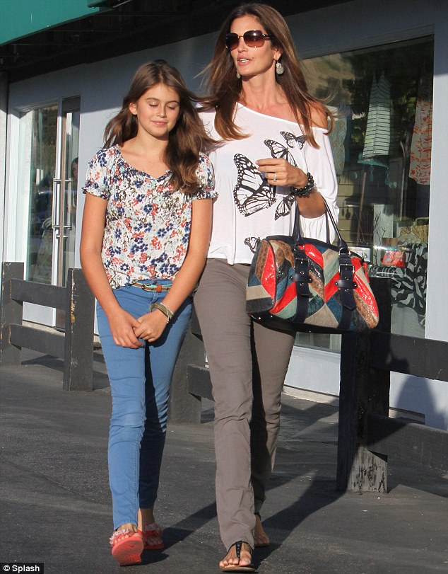 Bag lady: Cindy brightened up her casual ensemble with a colourfully chic designer bag