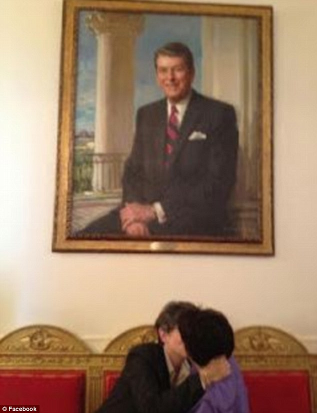 Two women were photographed kissing under President Reagan's portrait at the White House
