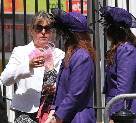 Dress code: The Royal Ascot fashion police issue a 'Fascinator' to a woman