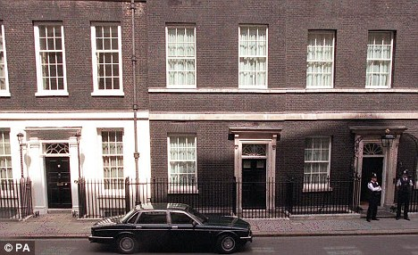 Trading places: Freya lives with the Osbornes in the flat above No 10 (right), while the Camerons and their cat Larry live above No 11 (left)