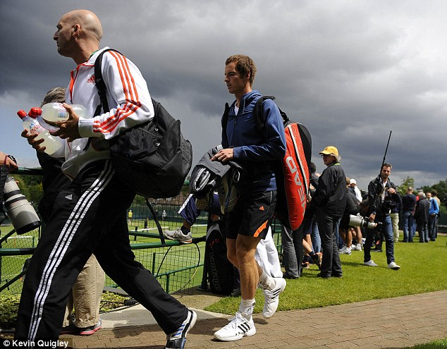 In the spotlight: Murray arrives for his session at the All England Club on Sunday