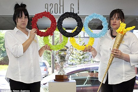 Taken down: This paper Olympic ring and torch display had to be removed from this florist shop's window in May when accused of violating the new copyright law