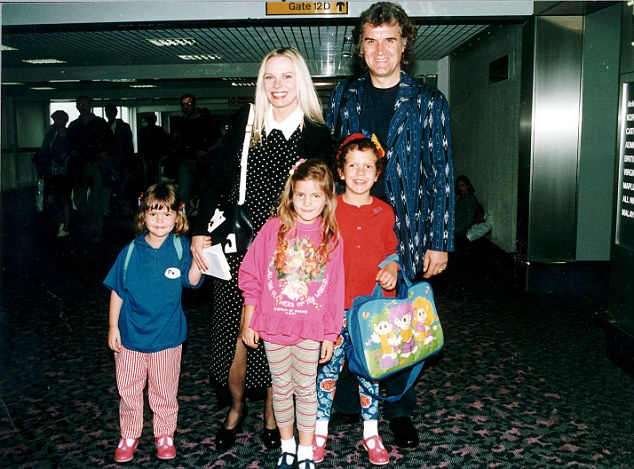 Doting parents: Billy and Pamela with Aimy, Daisy in Scarlett back in 1997