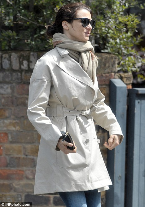 Prepared for all eventualities: The odd weather in London meant that Rachel needed both sunglasses and a trench coat