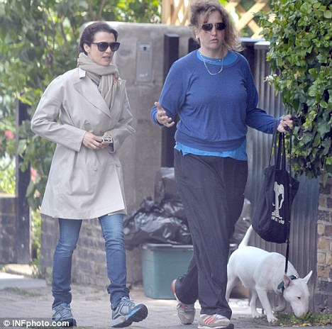 Walkies: Rachel and her friend were deep in conversation as the adorable pooch ambled along the street