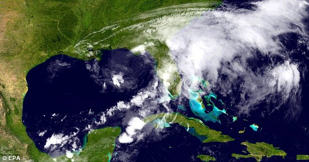 Covered up: Florida can barely be seen under Debby in this satellite image released by the NOAA