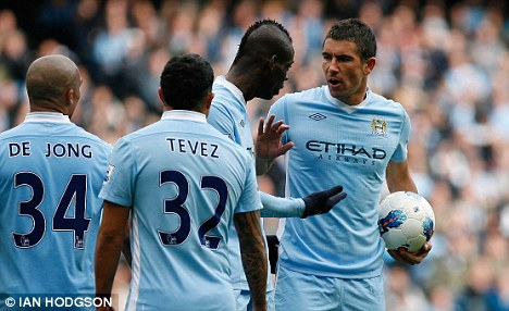Centre of attention: Kolarov (right) had been linked with Inter Milan and Juventus in Serie A