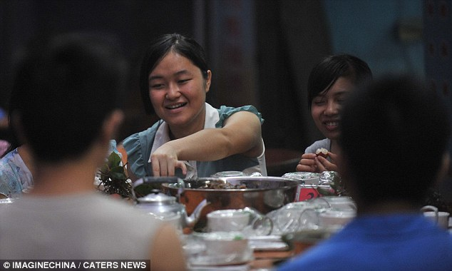 Dog dinner: Diners tuck into a meal which includes dog in Yulin, Guangxi province, China. The tradition dates back thousands of years