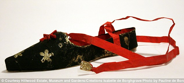 Delicate: Ballerina slippers decorated in gold with a red ribbon inspired perhaps by the Russian ballet