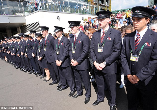 Prepared: A line of security guards waits to let the crowds into the All England Tennis Club at SW19