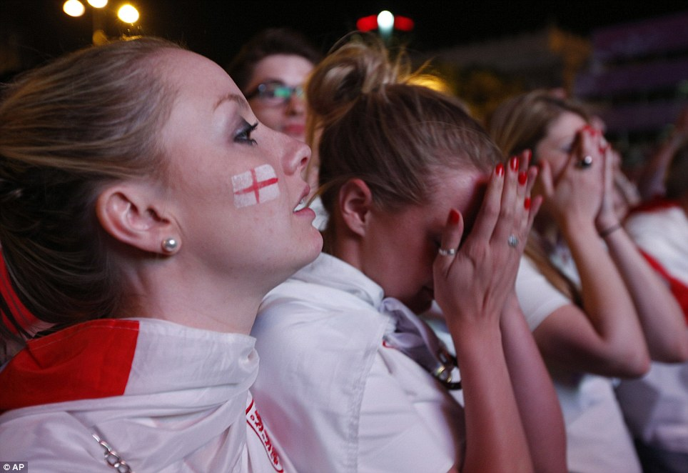 Beaten: England fans react during last night's 2012 match in the fan zone in Warsaw, Poland