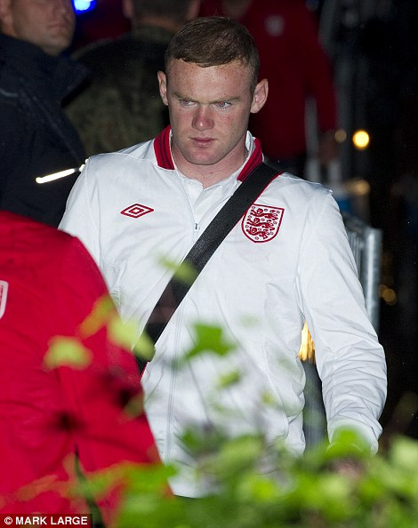 Defeat: Wayne Rooney arrives back at the team hotel in Krakow