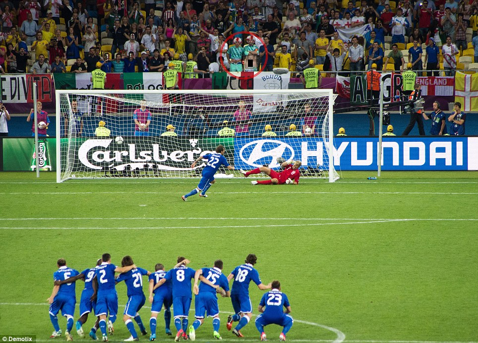 The Italian Job: Alessandro Diamanti holds his nerve and scores the penalty - despite the best efforts of the England fan to put him off