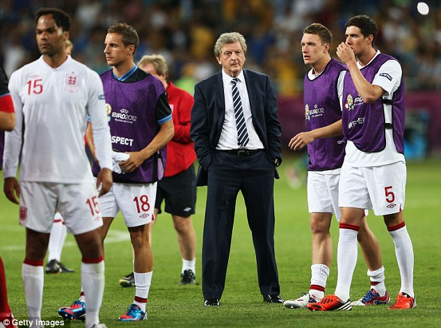 Stoic: Roy Hodgson reacts to England's defeat against Italy in the Euro 2012 quarter final