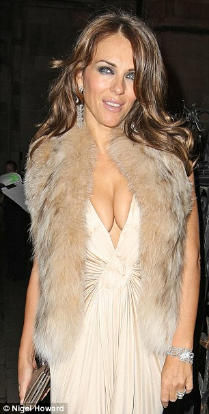 Out and proud: Actress and model Liz Hurley was placed higher up the poll for best cleavage than screen goddess Sophia Loren and burlesque star Dita Von Teese