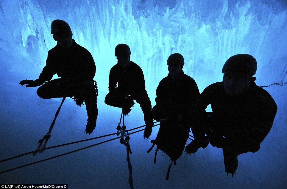 Hanging on: A Royal Marine detachment from HMS Protector crevass in Rothera, Antarctica, in another shot from Arron Hoare's award-winning collection