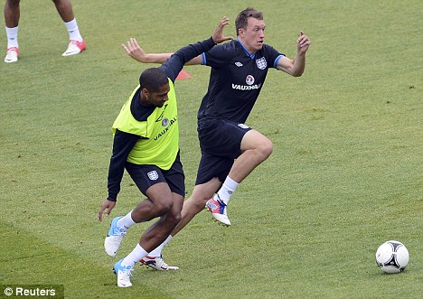 Missing man: Phil Jones (right) was limited to the training ground at Euro 2012
